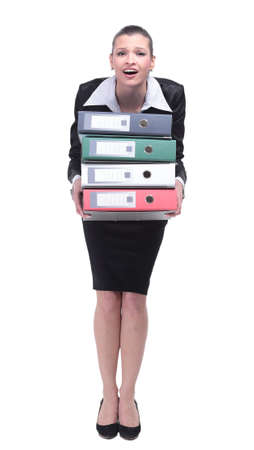 A tired employee in a business suit is holding a folder