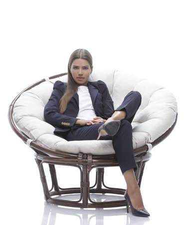 young business woman relaxes in a round chair Reklamní fotografie