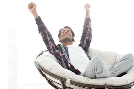 stylish guy stretching in a comfortable chair Stock Photo