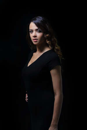 Beautiful woman with evening make-up in black dress Stock Photo