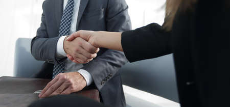 Handshake,Business man holding hands together closeup
