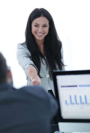 business woman welcomes colleague with handshake Banco de Imagens