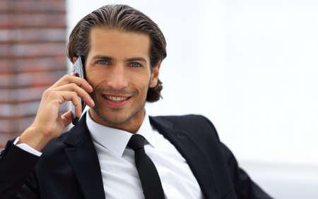 business man talking on smart phone.