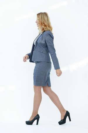 modern woman confidently striding forward