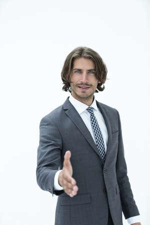 Smiling friendly businessman offers a handshake