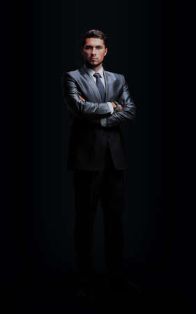 portrait of successful businessman on black backgro 写真素材