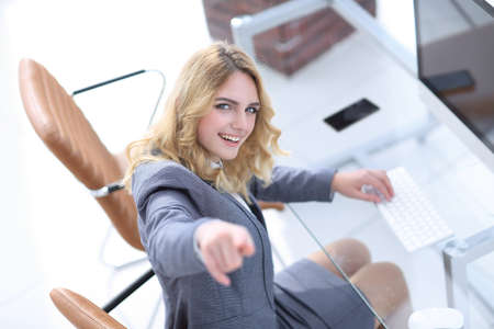 closeup.smiling business woman showing forward Stock Photo