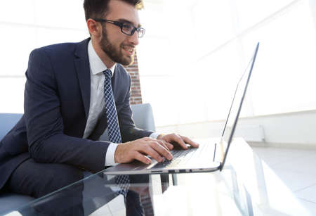 Concentrated professional IT developer with laptop