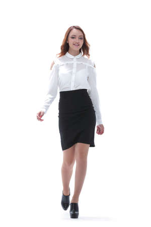 Successful business woman walking - isolated over white