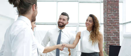 business women greet each other with a handshake Archivio Fotografico
