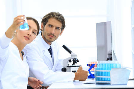 Team of Biologists Researchers Working in Laboratory Stock Photo