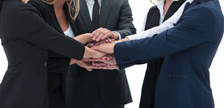 friendly business team with hands clasped together.