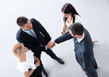 view from the top. business partners shake hands. Reklamní fotografie - 91692274