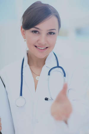 Smiling medical doctor woman stretching hand for handshake