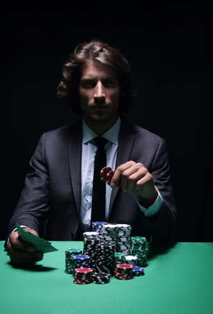 The poker player in a casino Stock Photo