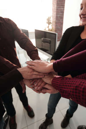successful business team with hands clasped together.