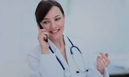 Doctor talking on telephone