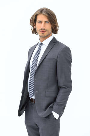 picture of a business man while holding both hands in pockets Imagens