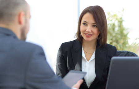 business woman sitting at a Desk in the office. Stock Photo