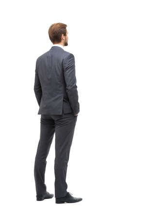 rear view . businessman looking at copy space