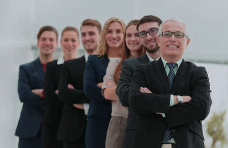 Successful team of staff standing in a row Imagens
