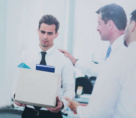 dismissed businessman carrying box Stock Photo