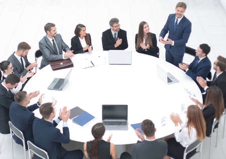 business people applauding speaker at a business meeting. Stock Photo