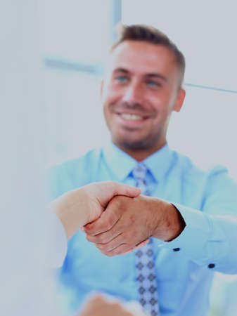 businessman shaking hands to seal a deal with his partner.