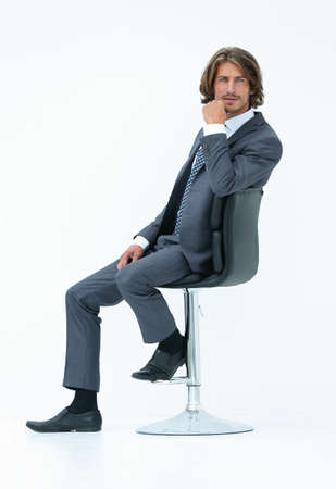 Image of successful businessman in elegant suit seated on chair