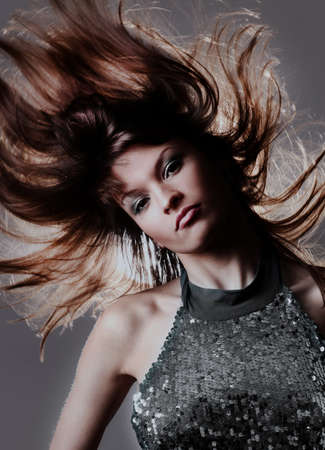 Portrait of beautiful and fashion model woman with blown hairs.