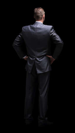 Back view of a business  man standing isolated on white