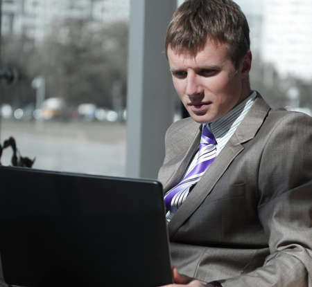 Business man working at office with laptop on his desk.