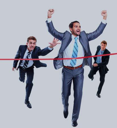 Happy businessman running through finishing line. Isolated on white.