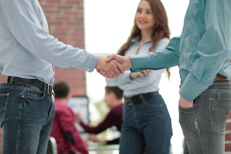 Handshake between businesspeople in a modern office. Stock Photo