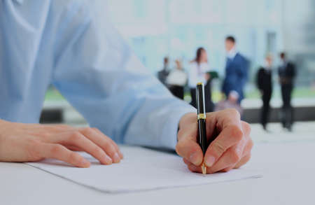 Businessman is signing a contract.