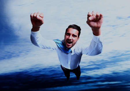 Happy businessman flying in the sky. Stock Photo