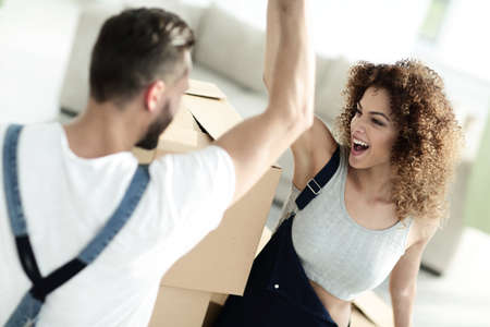 young couple giving five when moving to a new apartment Stock Photo