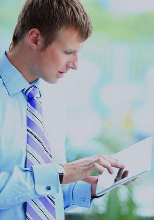 Businessman using his tablet in the office. Stock Photo