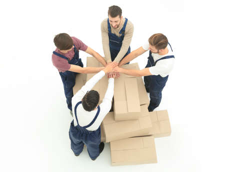 Happy smiling movers carrying boxes, isolated on white backgroun Stock Photo