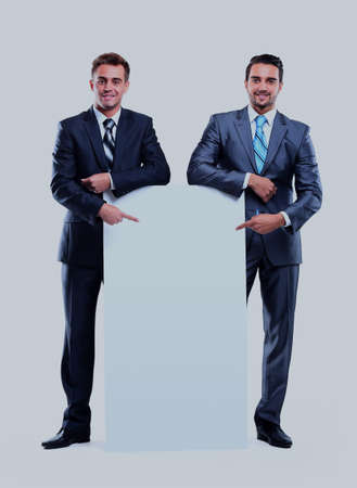 Two smiling business man showing blank signboard, isolated over white background.