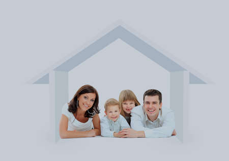 Happy family in a house. Isolated over a white backgroun.