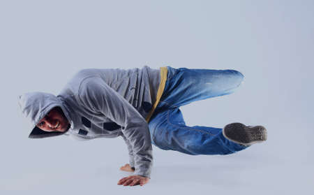 Young handsome fresh man breakdancing with stylish clothes. . Stock Photo