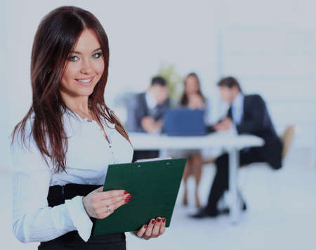 Young businesswoman and her colleagues. Stock Photo