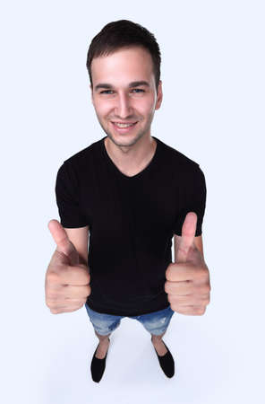 concept of success.stylish guy with big head showing thumbs up. Stock Photo