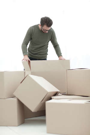 confident man unpacking boxes in the new house
