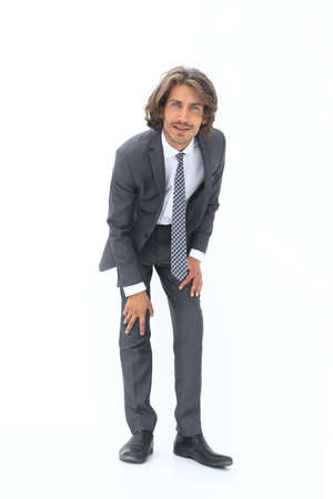 Young handsome businessman bending down. Stock Photo