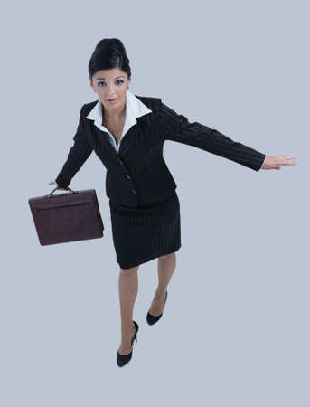Successful business woman with suitcase