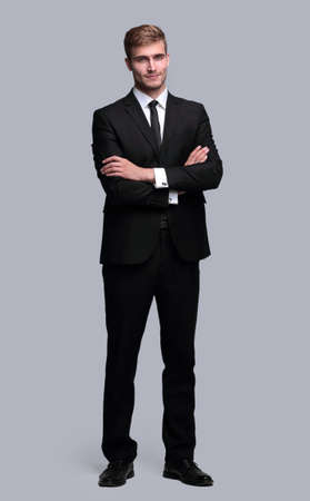 portrait in full growth. successful businessman with arms crossed in front of him. Stock Photo