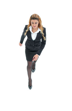 view from the top.confident business woman walking forward