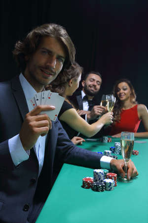group of sinister poker players Foto de archivo